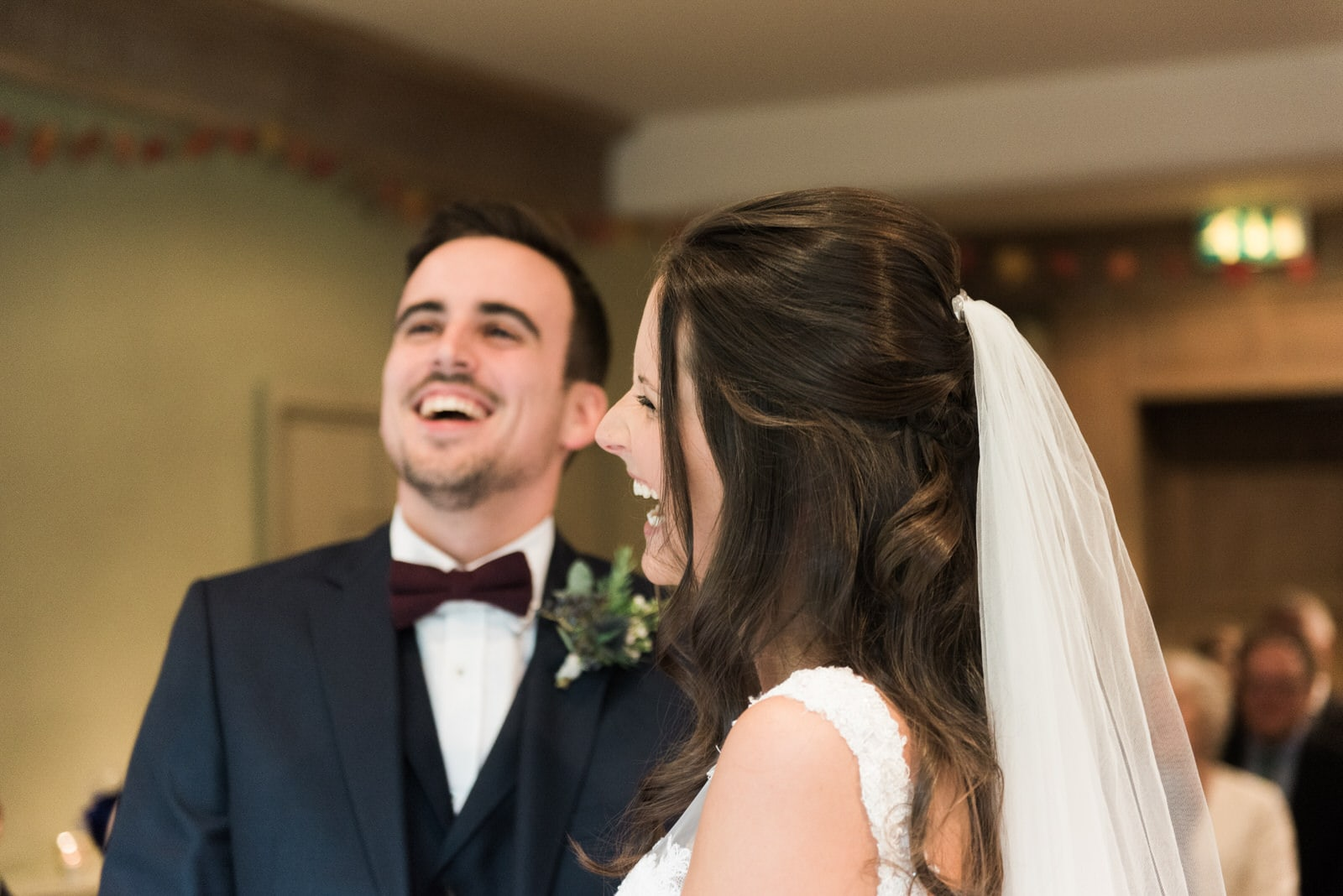 Bride and groom laughing during wedding ceremony at Whirlowbrook Hall