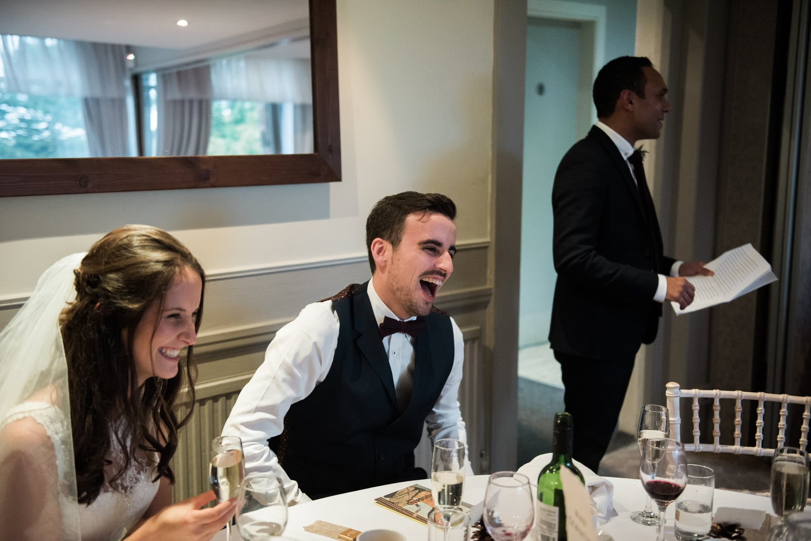 Whirlowbrook Hall wedding photography - bride and groom laughing during speeches