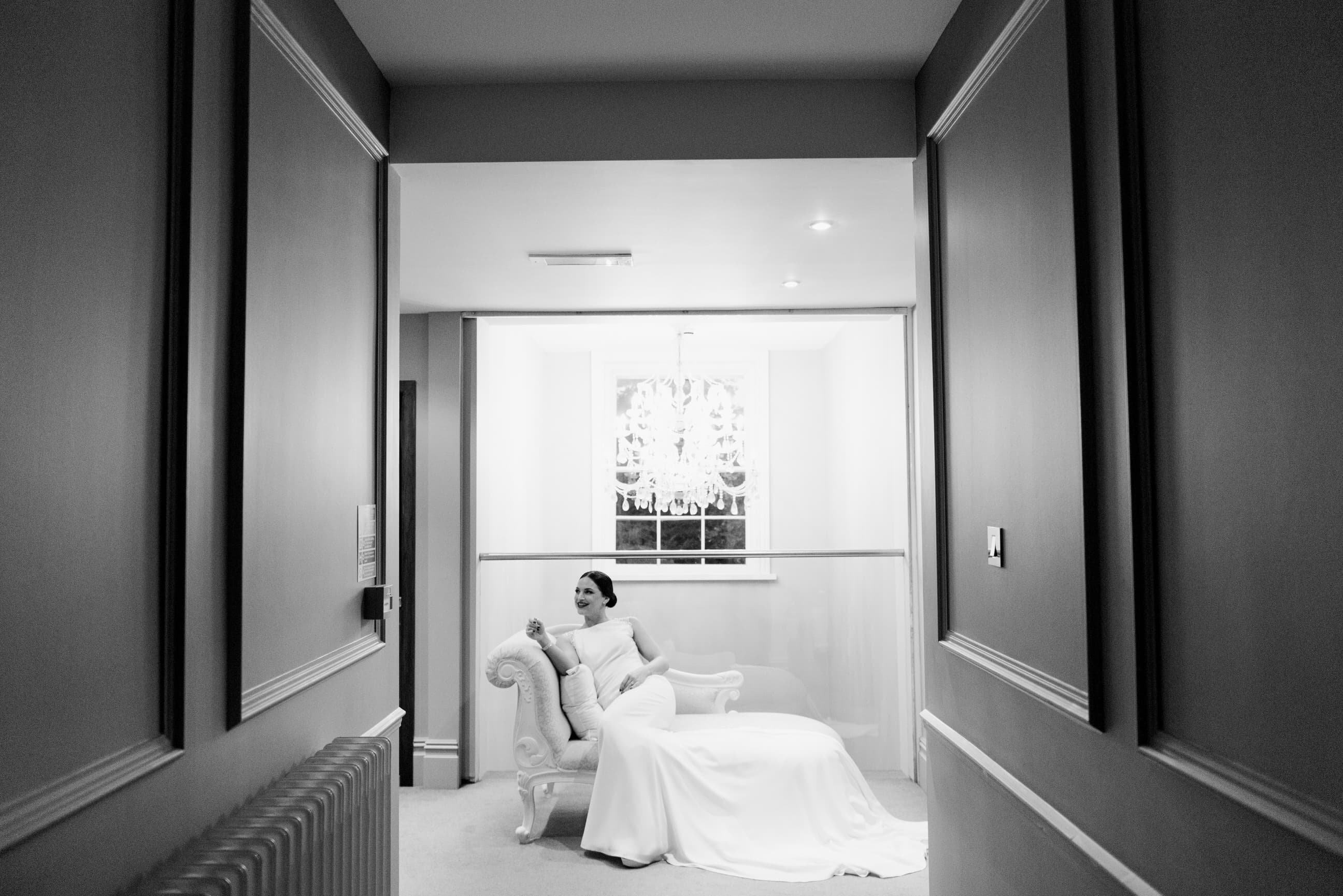 Bride sat on a seat in a corridor