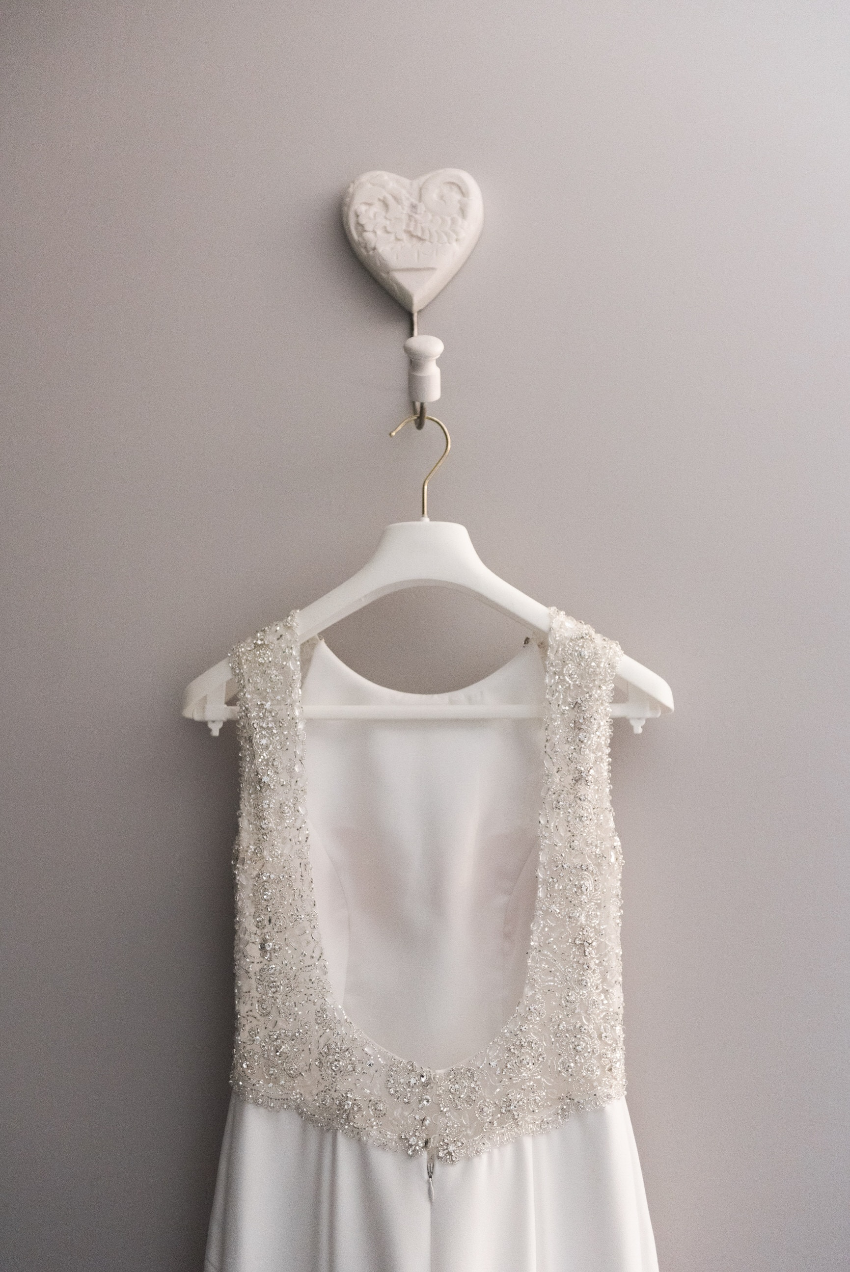 Wedding dress hung on hanger