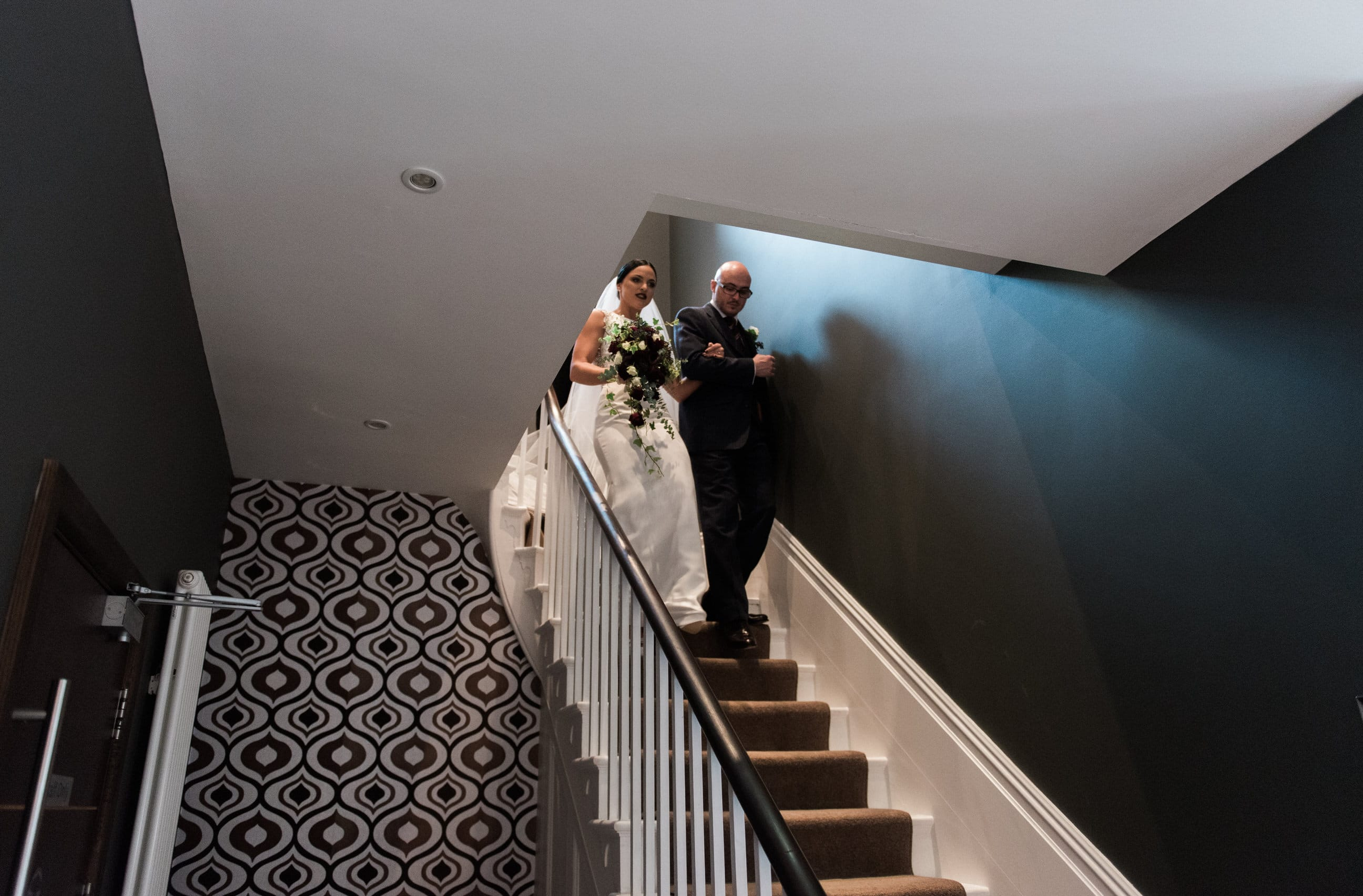 Bride and groomsman walking down the stairs