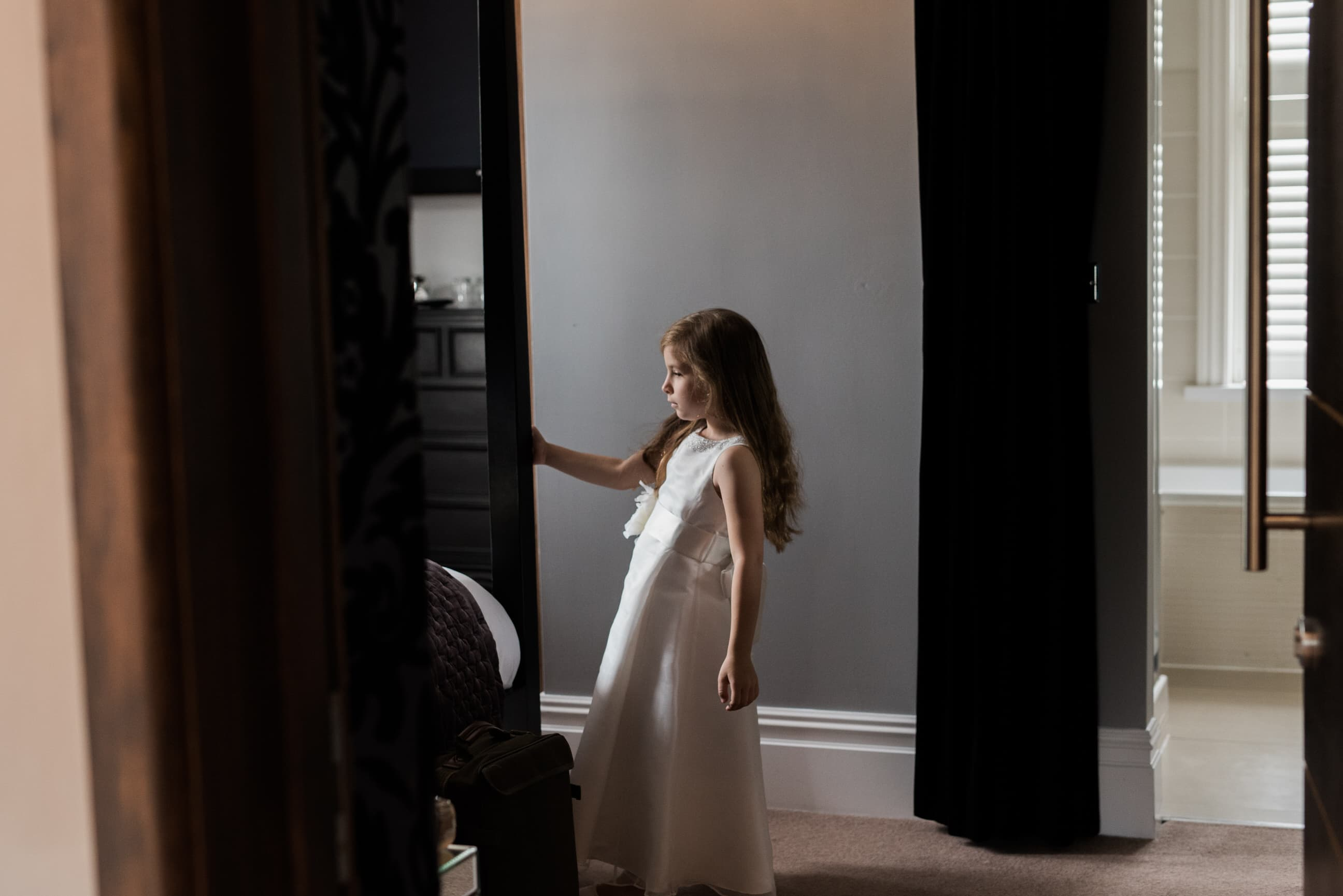 Young bridesmaid stood in a room