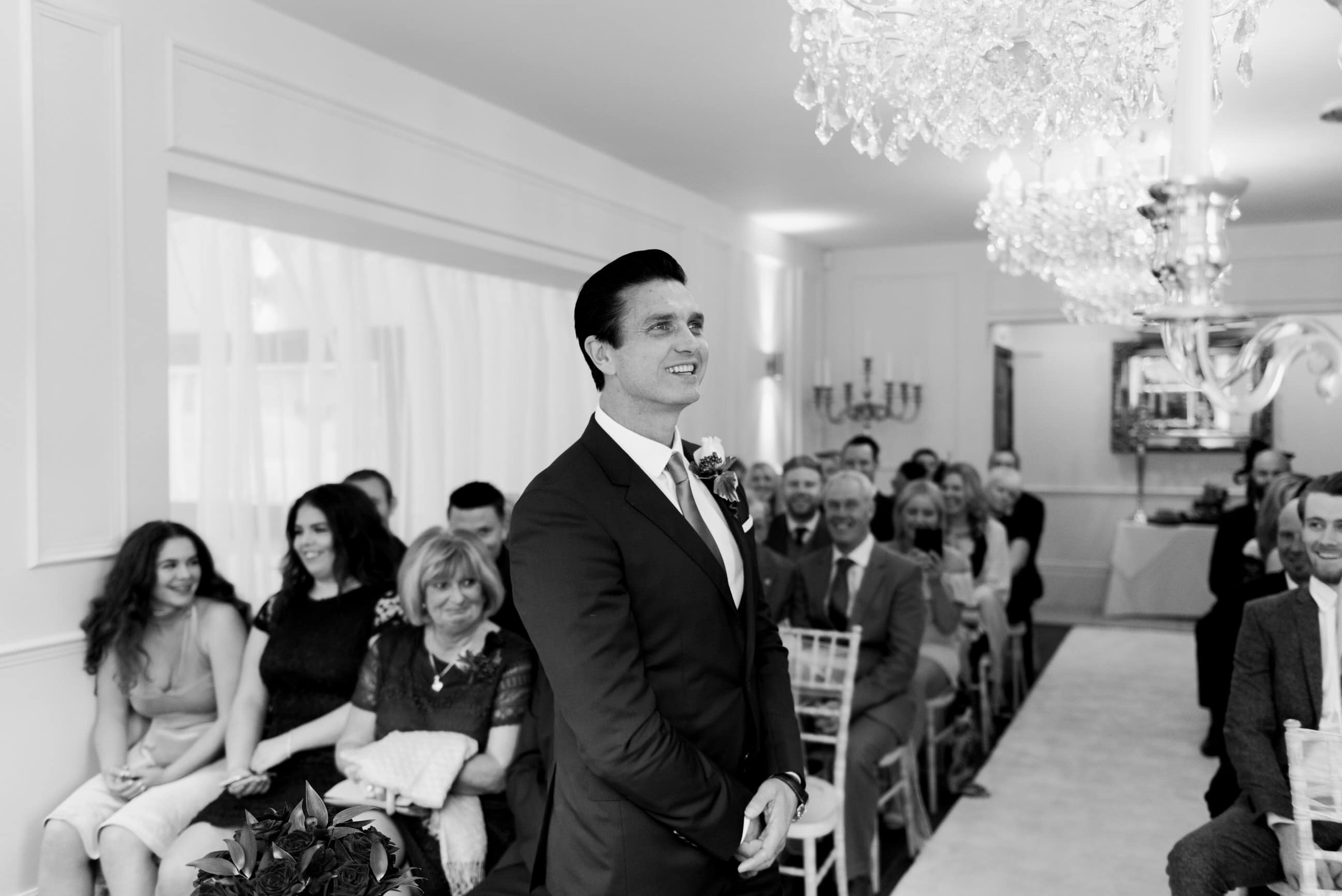 Groom waiting for bride to arrive, smiling