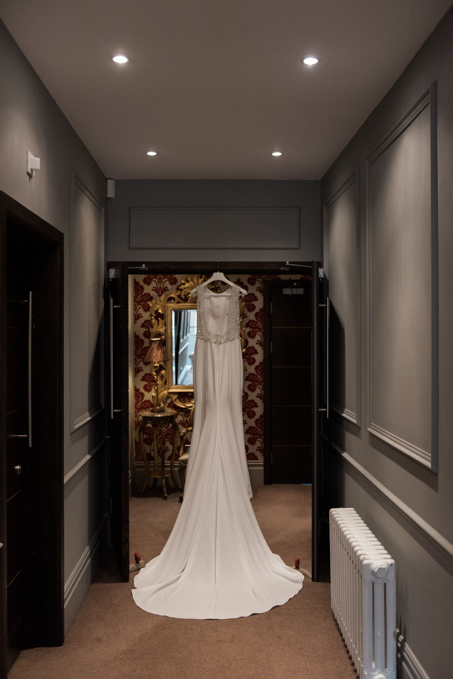 Pronovias wedding dress hung in doorway
