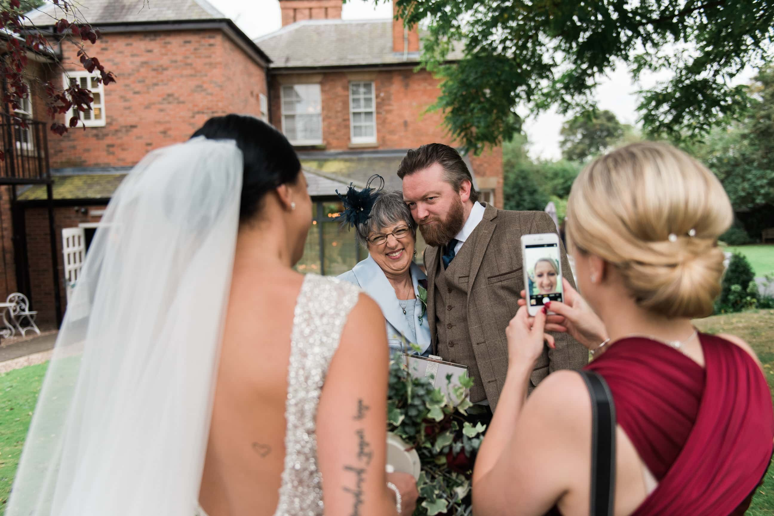 Bride with wedding guests having a selfie