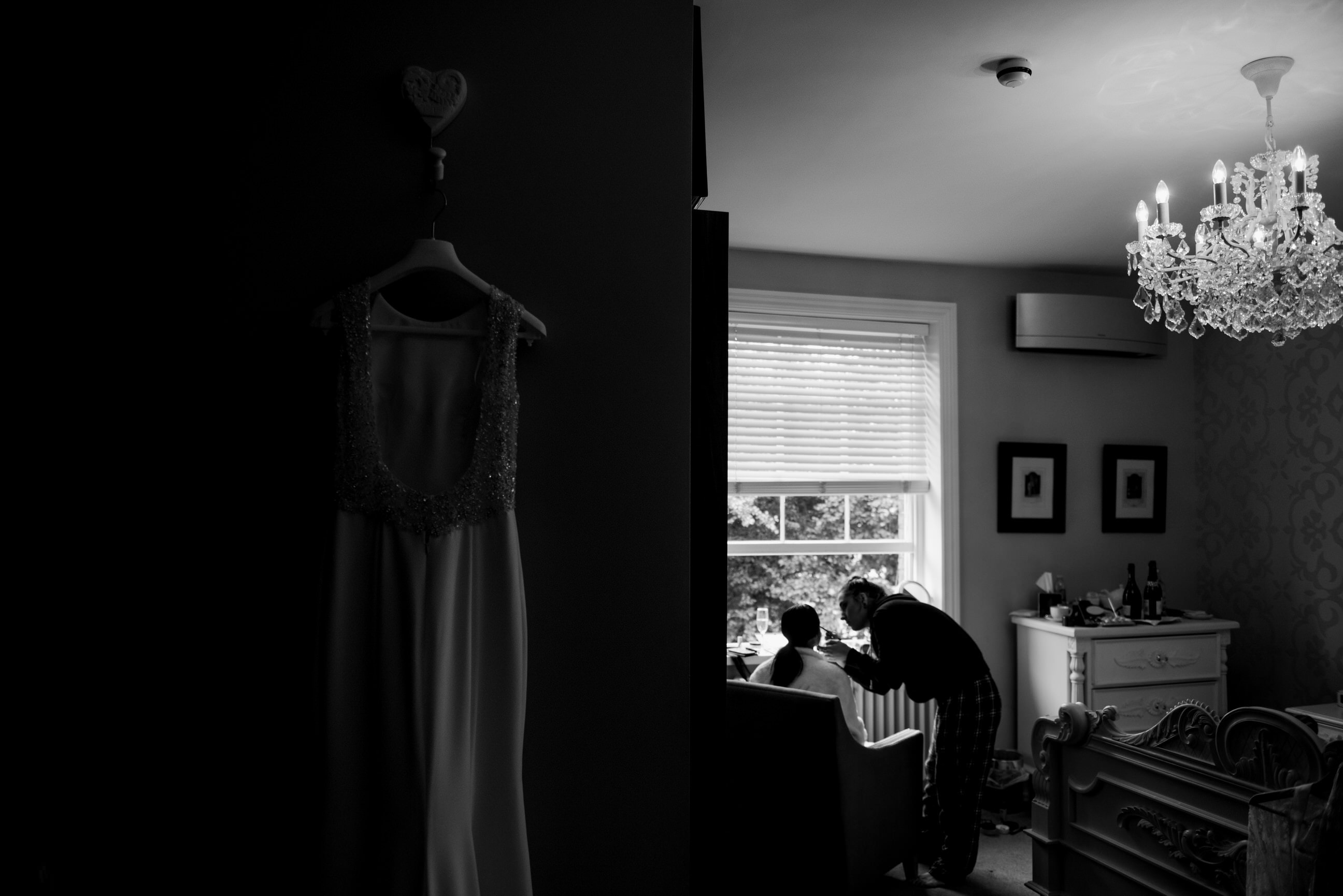 Bride getting make up done in bridal suite