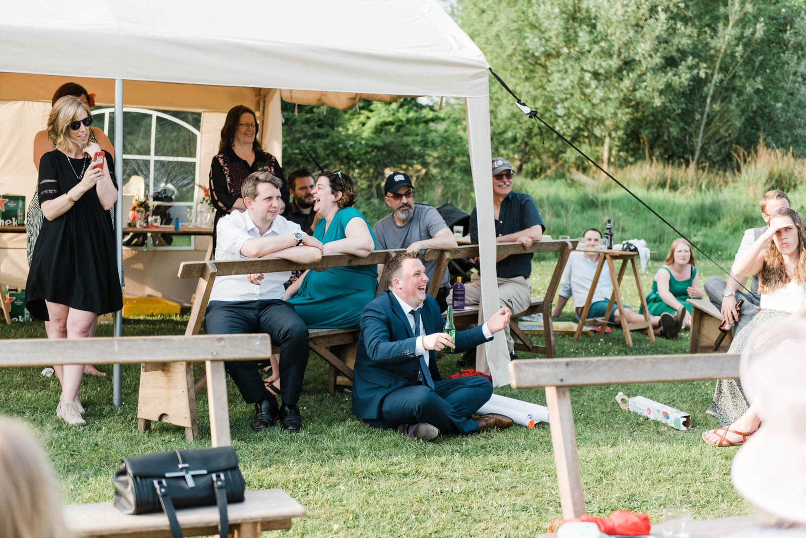 wedding guests laughing at speeches at Lancashire elopement