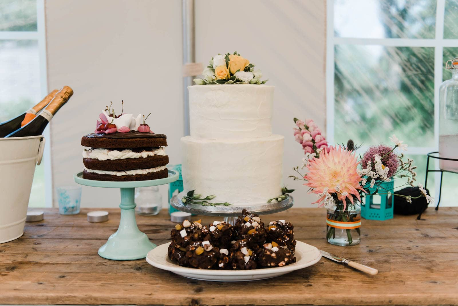 selection of wedding cakes and bakes on a wooden table at a Lancashire elopement