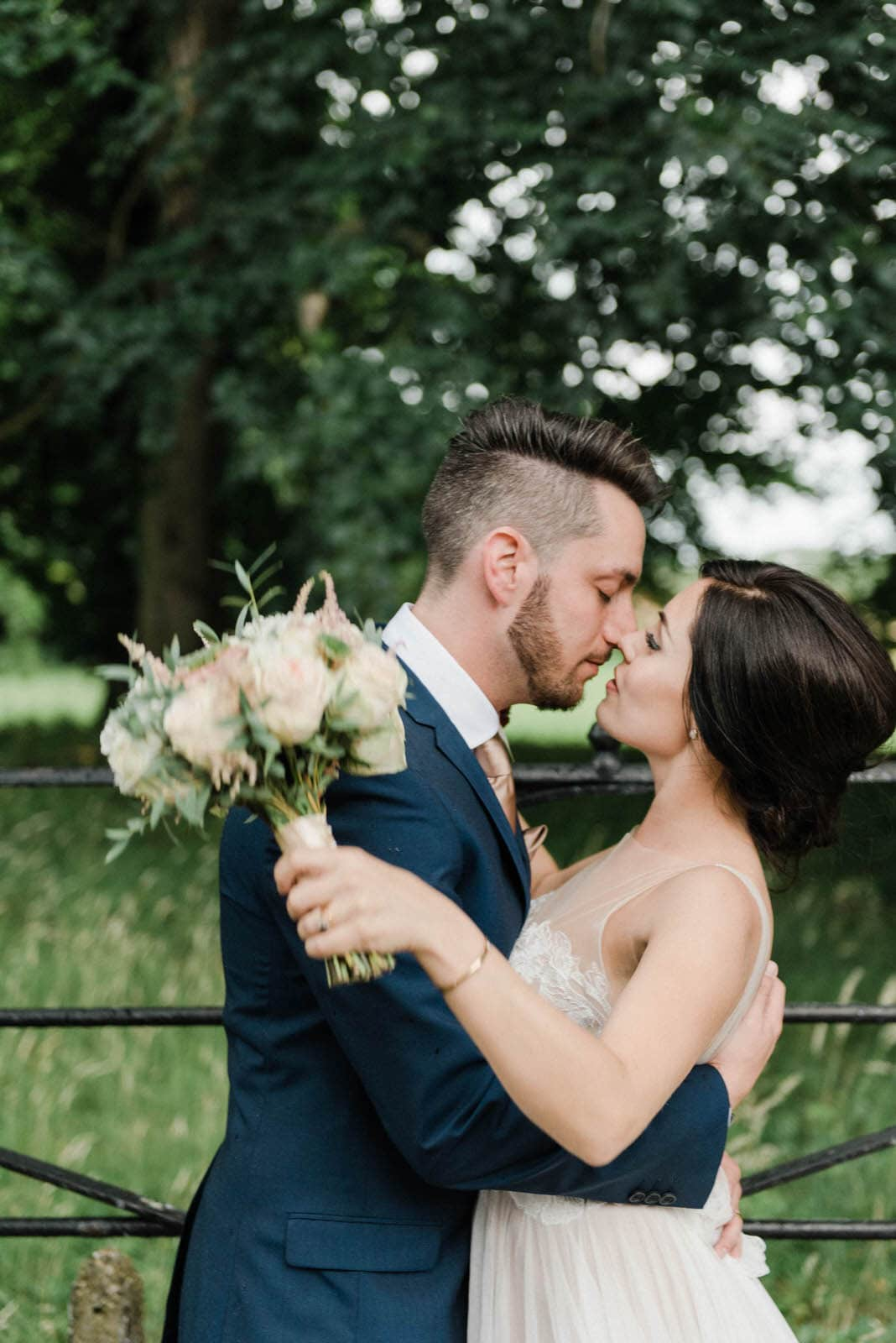 Fine art portrait of a bride and groom kissing at Oaklands Hall Hotel