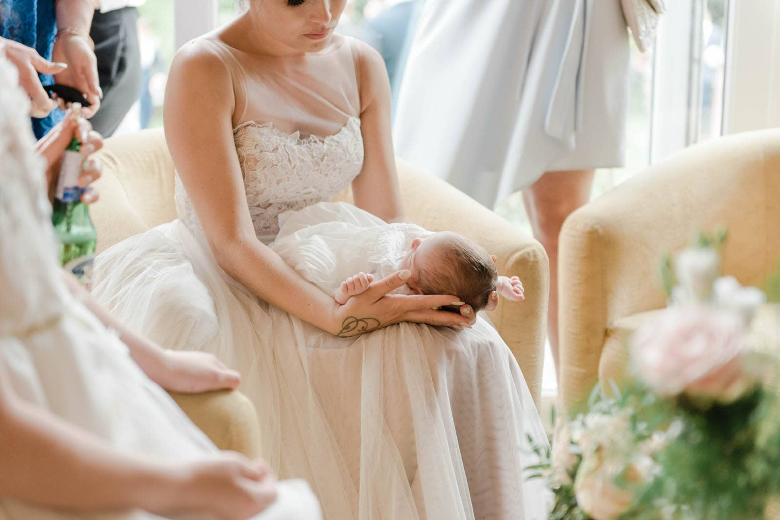 Bride holding a baby at wedding reception at Oaklands Hall Hotel in Grimsby