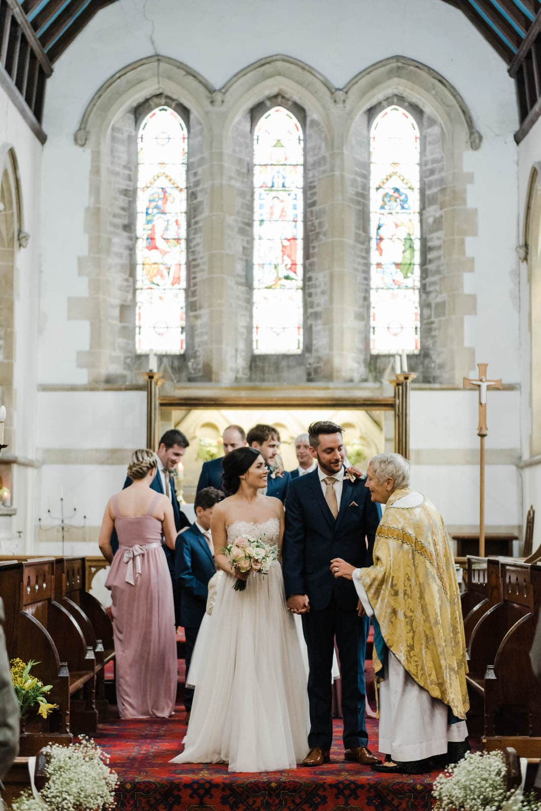 Bride and groom at their wedding ceremony in Harborough Church