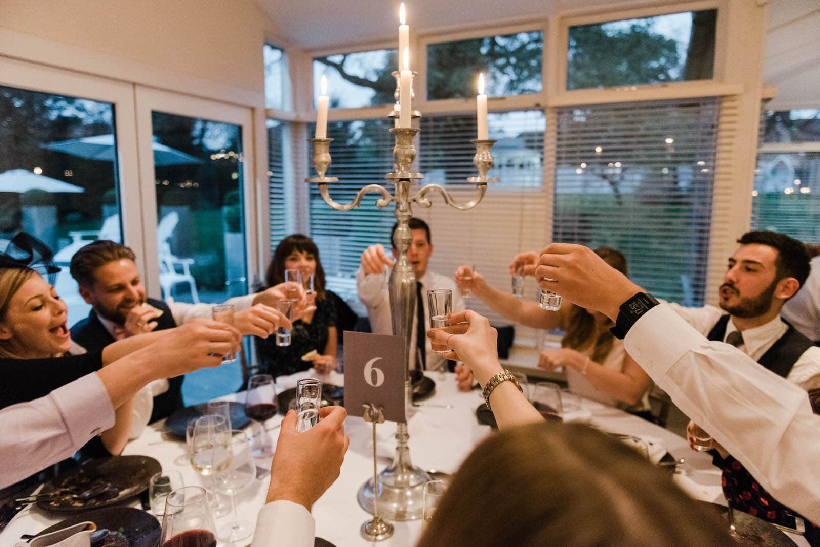 Wedding guests toasting with glasses during the speeches at The Old Vicarage Boutique