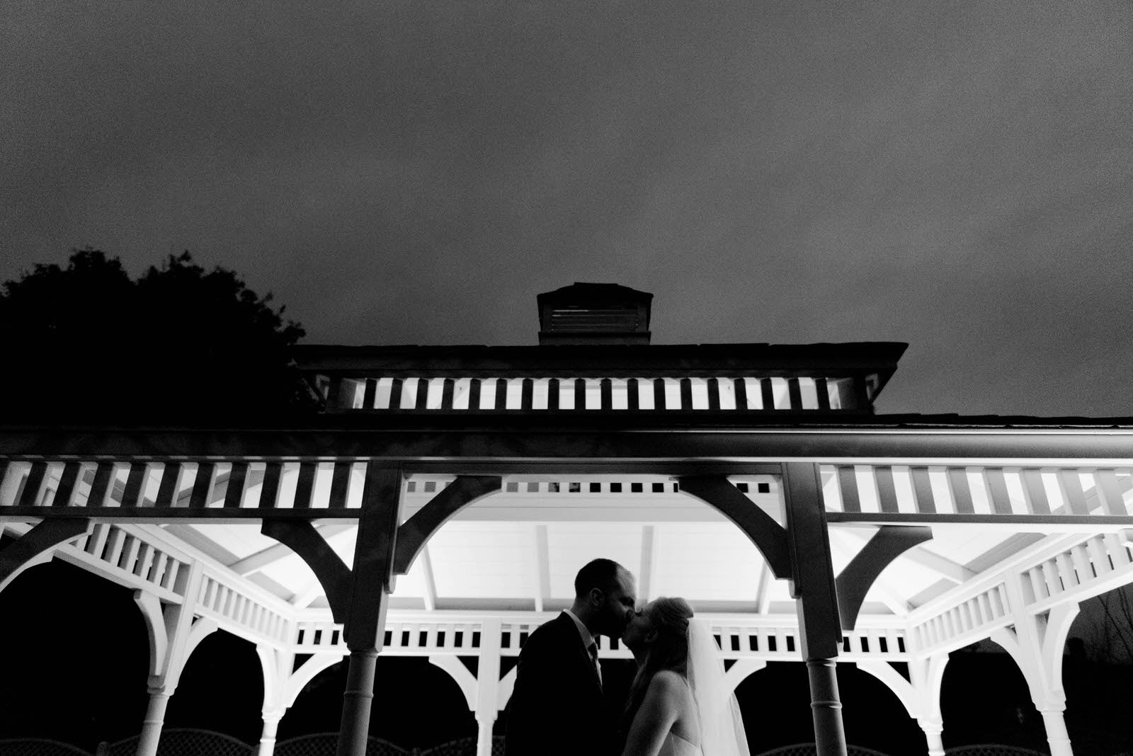Bride and groom outside under a veranda at The Old Vicarage Boutique Hotel