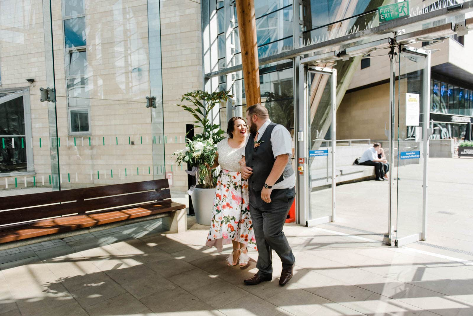 Bride and Groom walking into the Millennium Gallery in Sheffield for their wedding day