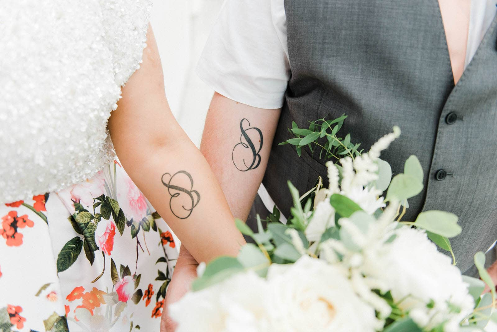 Alternative wedding photography of Bride and groom with matching wedding tattoos in Sheffield