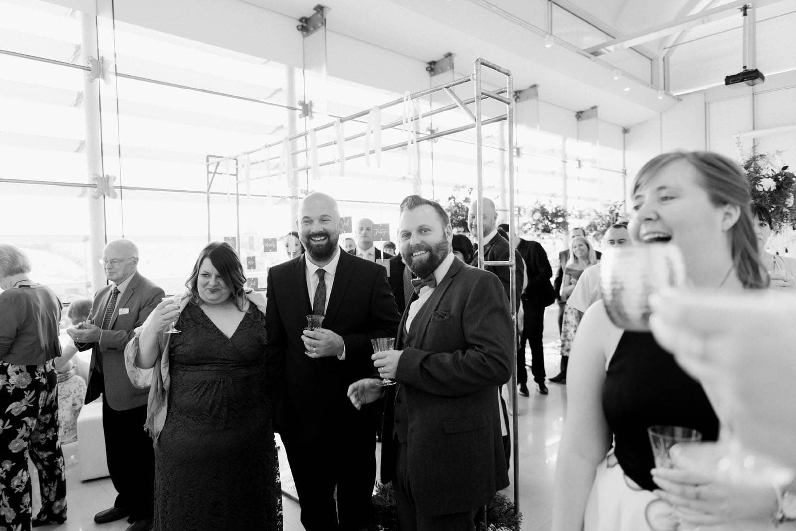 Documentary wedding photography of Wedding guests laughing at a wedding in Sheffield