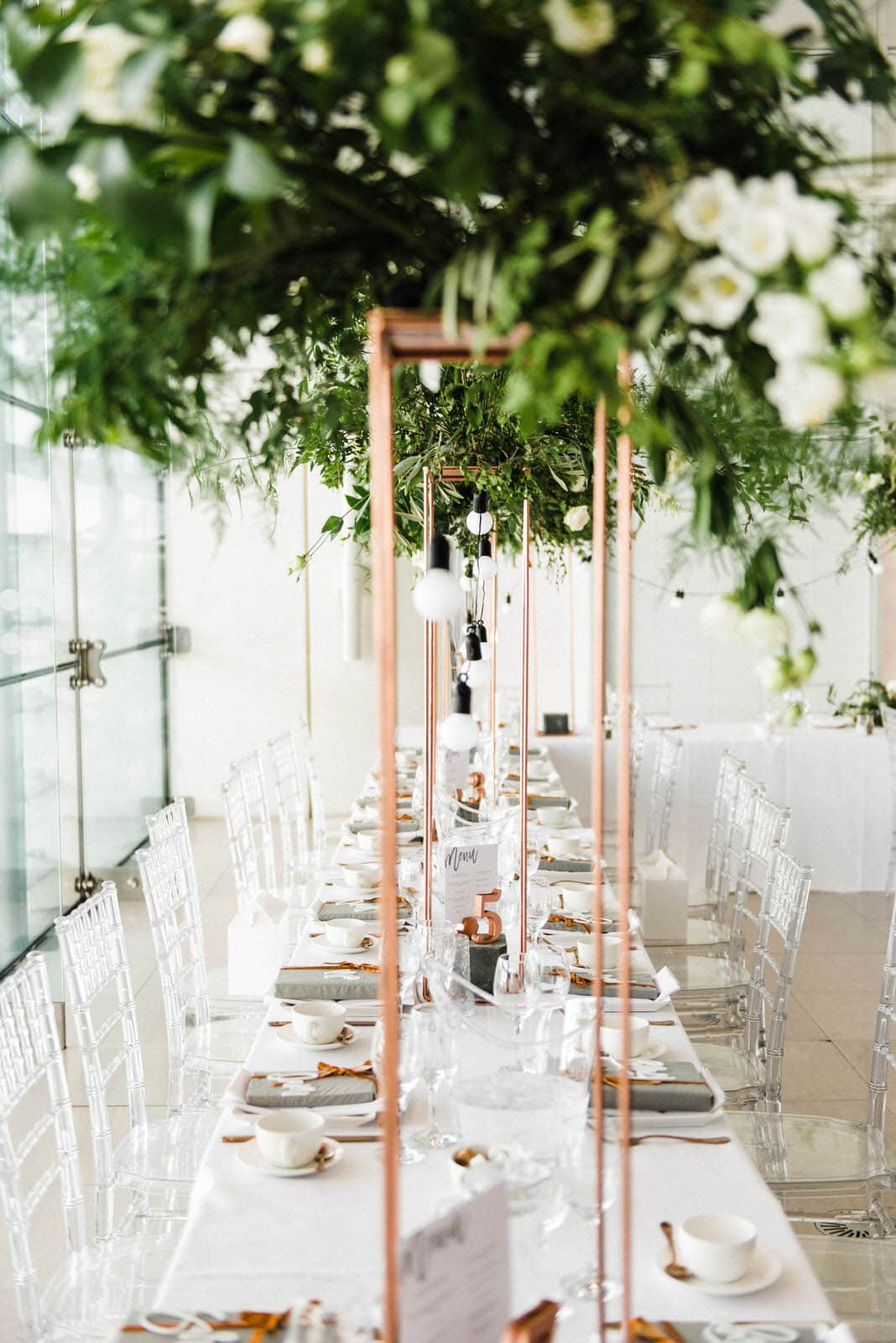 Banquet tables decorated with greenery, foliage and copper decorations in the Millennium Gallery in Sheffield
