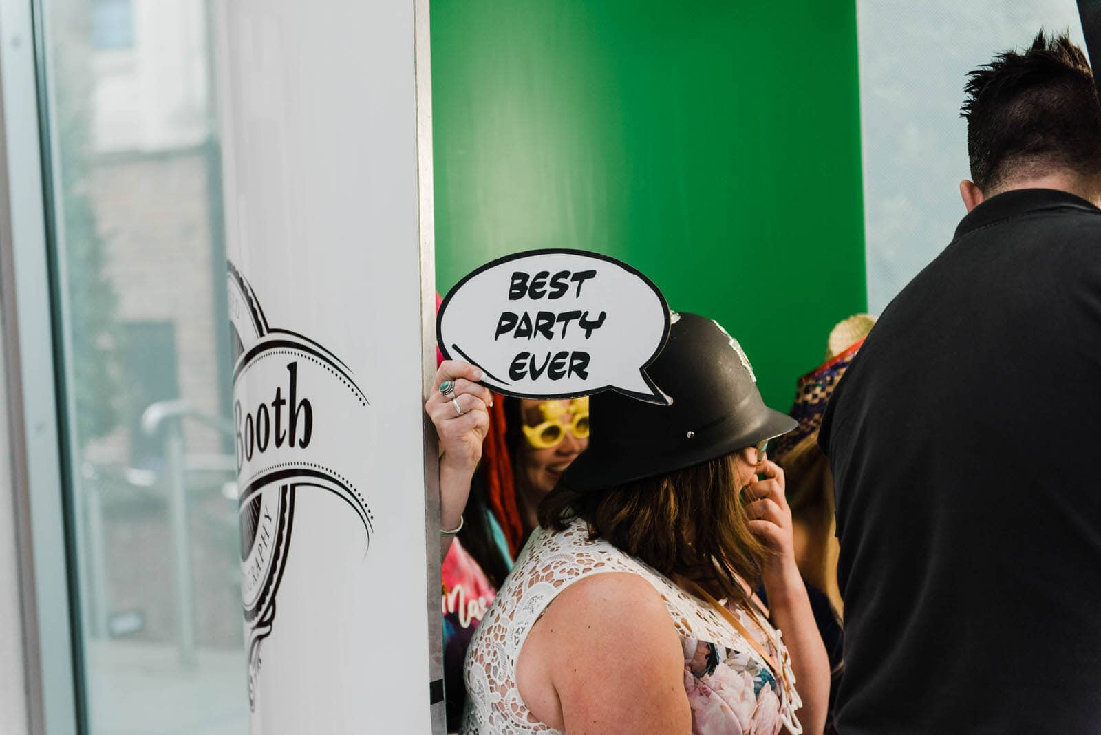 Wedding guests in photo booth at Millennium Gallery
