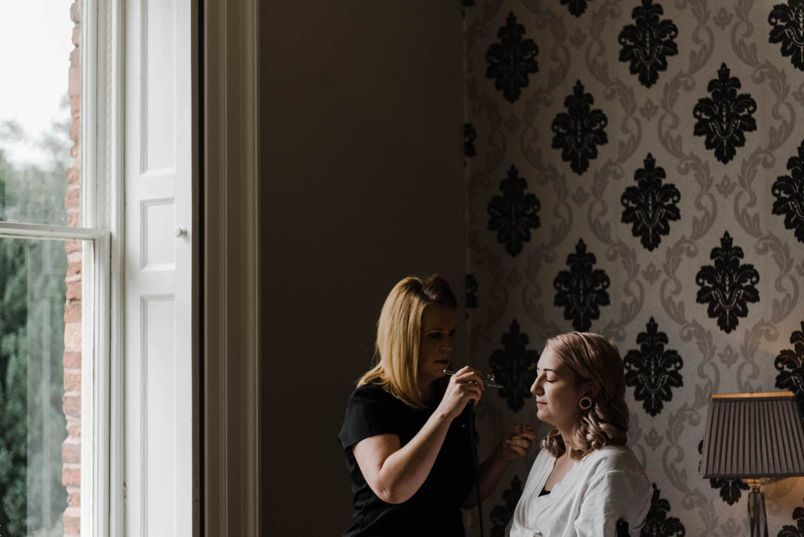 Bride having make up done at Hirst Priory