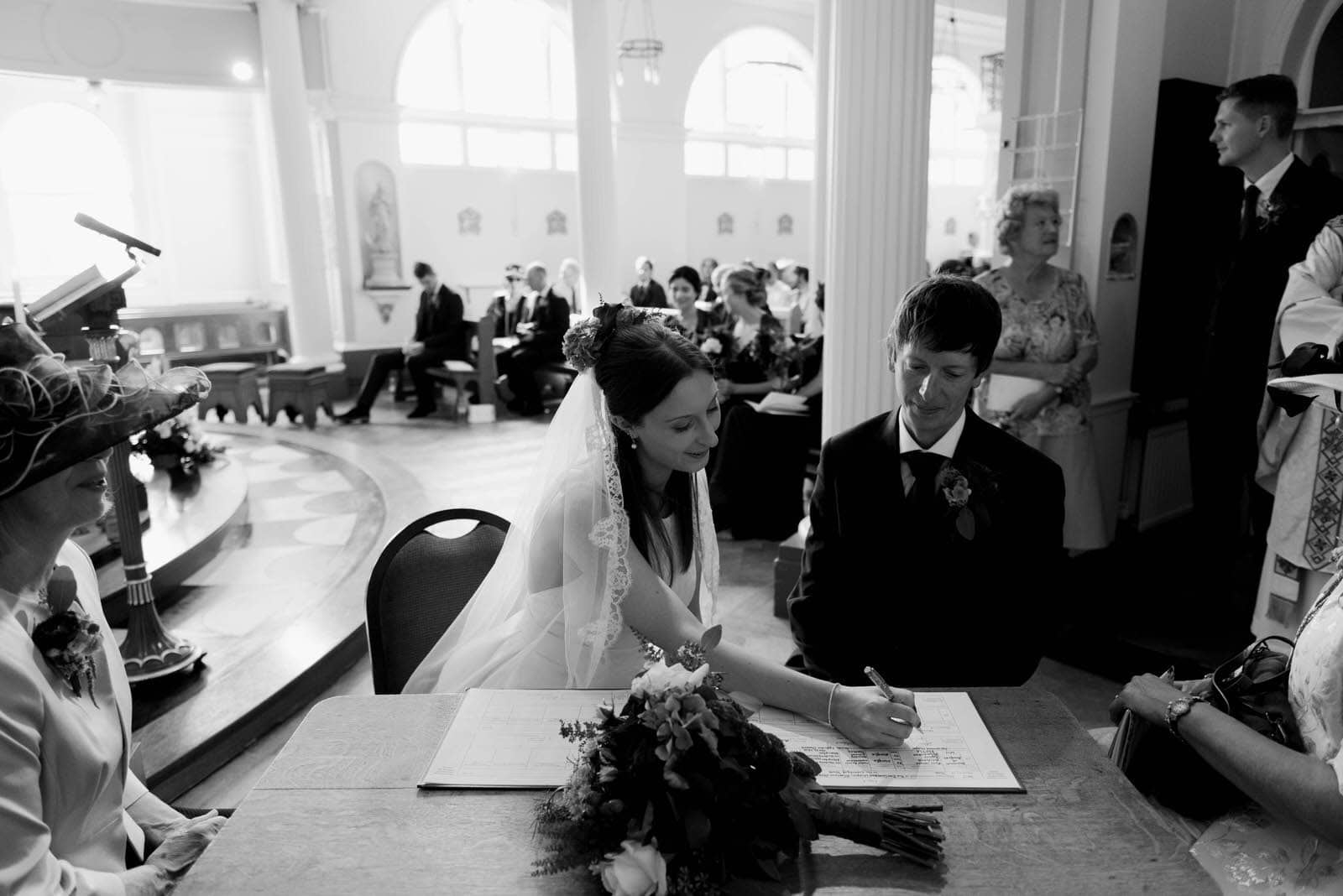 Couple signing the wedding register at Bar Convent in York