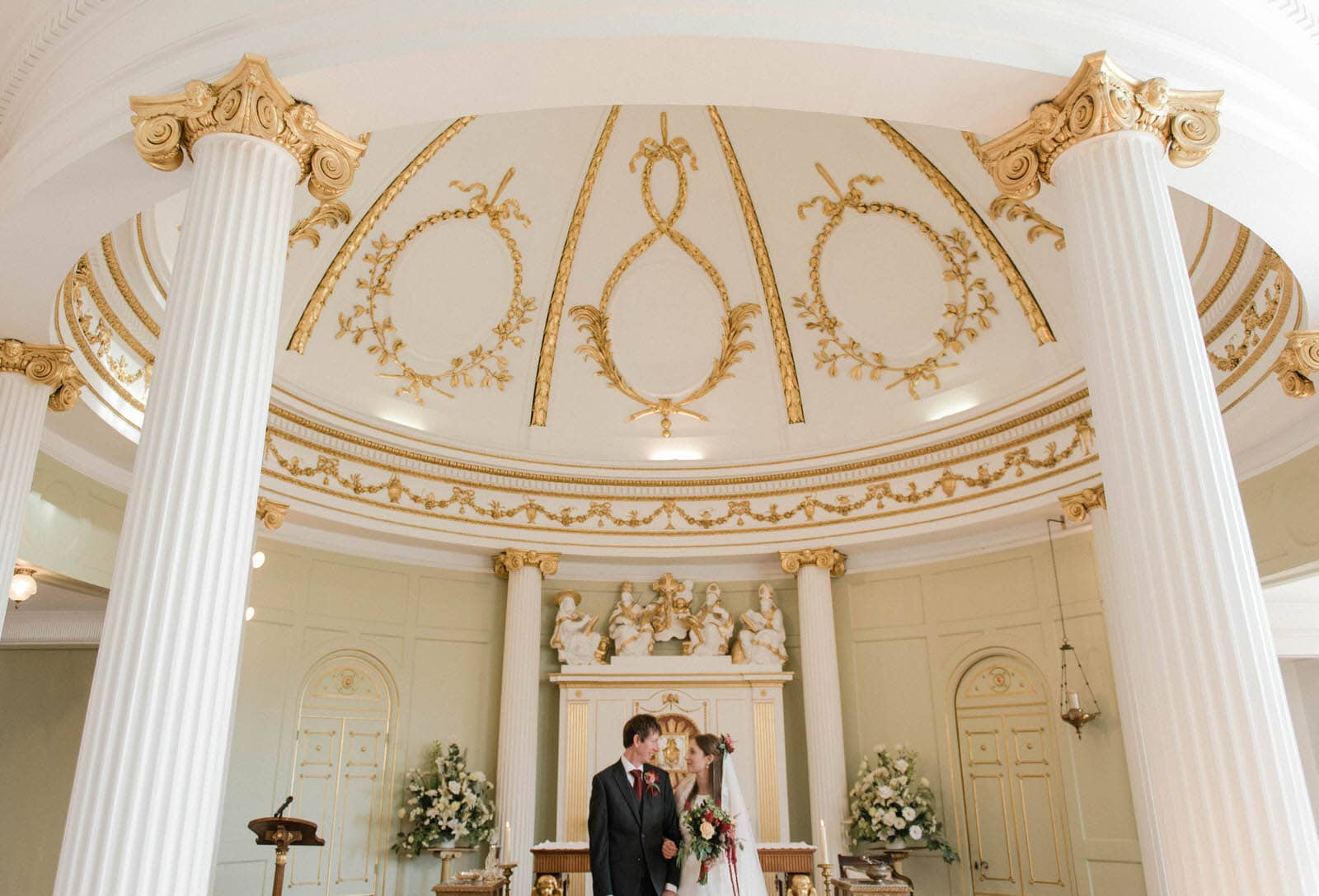 Wedding ceremony in York with the bride and groom stood in the beautiful, ornate Bar Convent Chapel