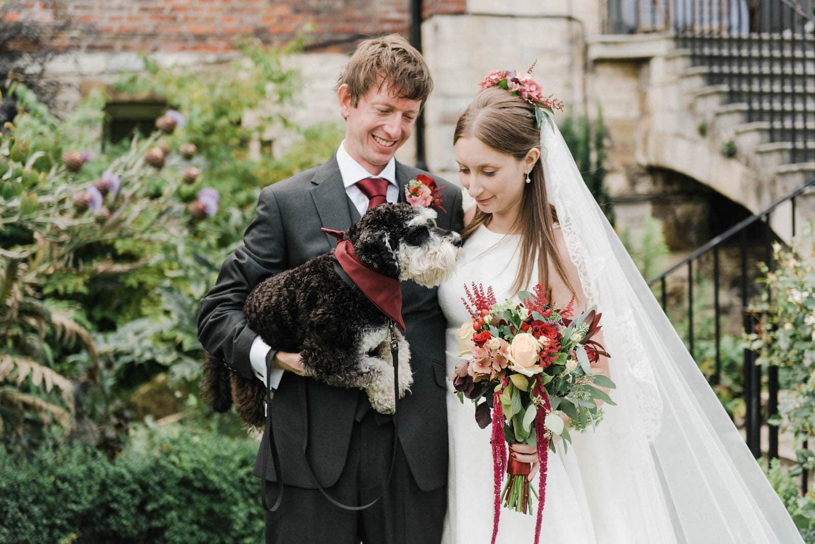 Bride and groom portrait with their dog outside Grays Court York