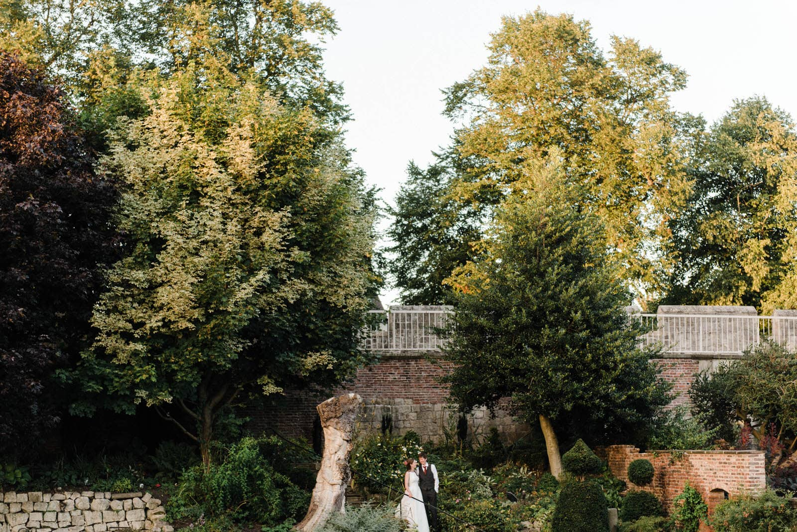 Beautiful sunset image of the bride and groom in the gardens at Grays Court York