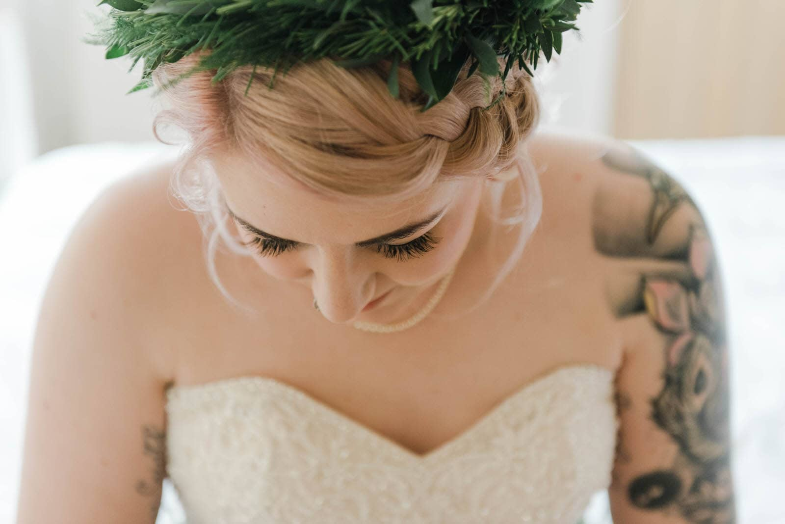 Bridal portrait of a beautiful tattooed bride at Hirst Priory wedding wearing a flower crown