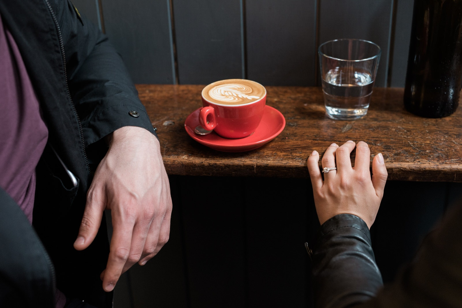 couples hands near a coffee cup in sheffield