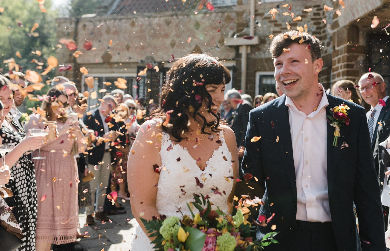 bride and groom in confetti shower voewood wedding