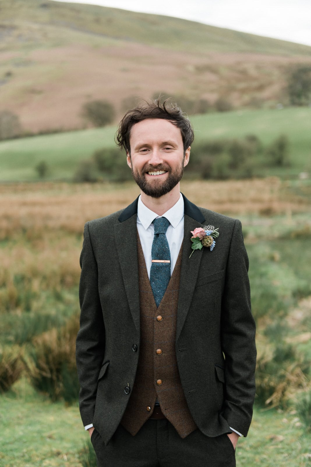 Groom portrait smiling - Lake District