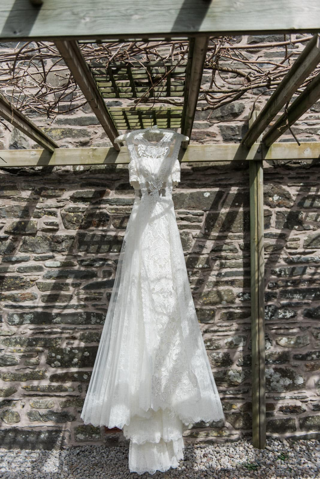 Yolan Cris wedding dress hung up at New House Farm