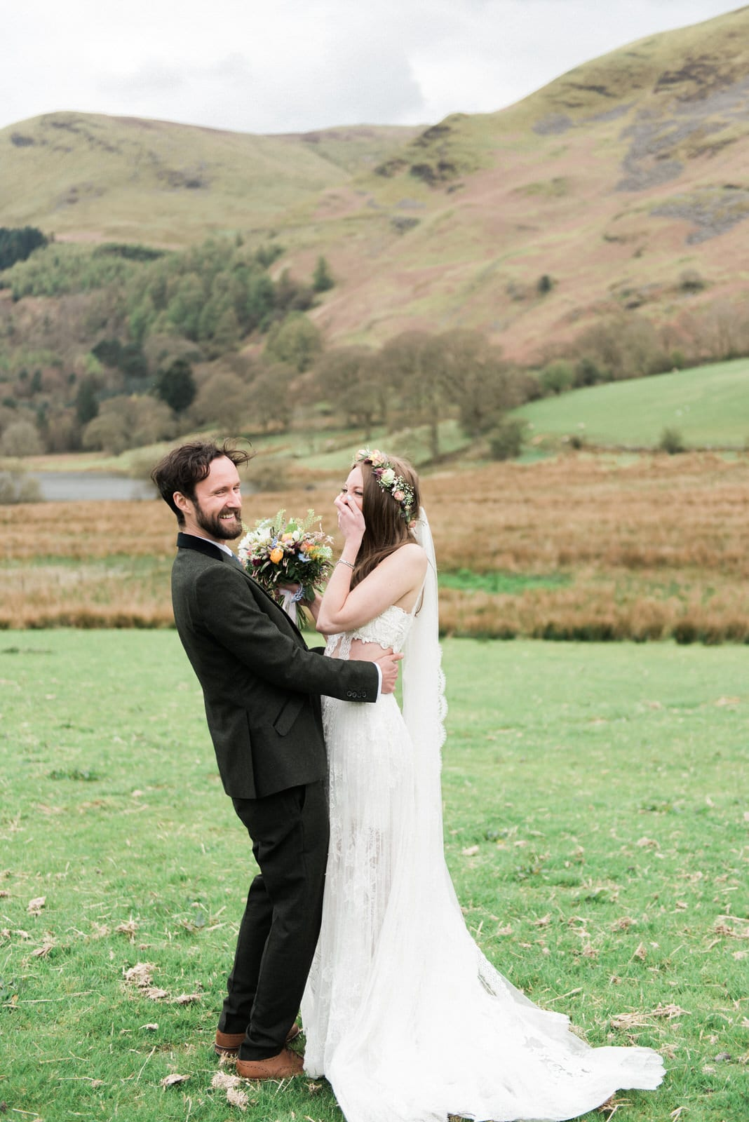 Bride & groom laughing in the Lake District