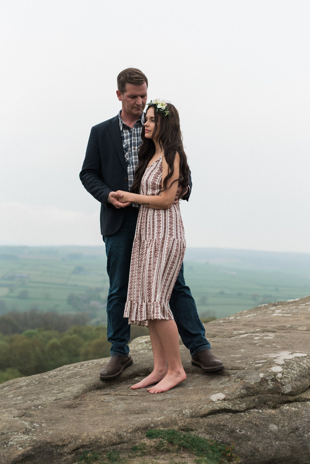 Couple on cliffside engagement shoot