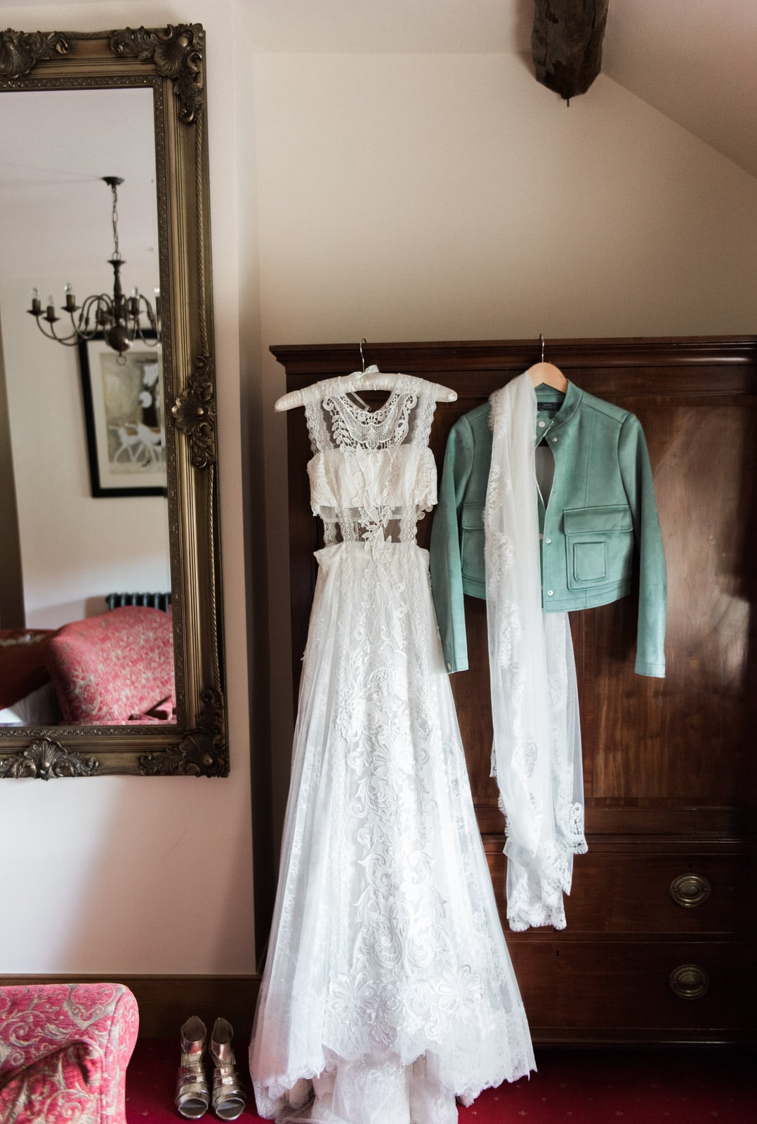 Yolan cris wedding dress hung on wardrobe