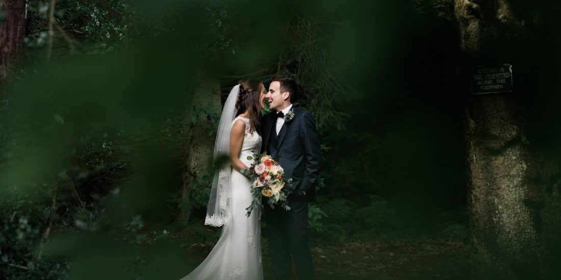 Bride and groom in woods at Whirlowbrook hall wedding