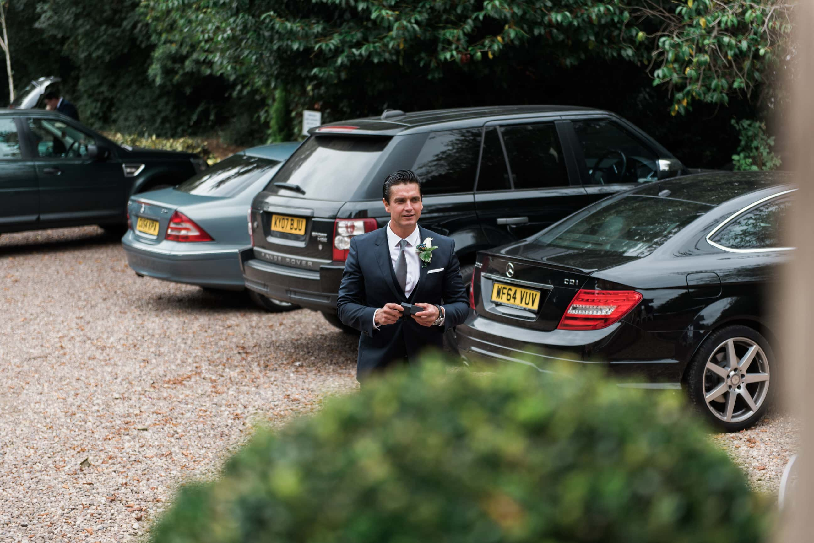Groom getting out of car