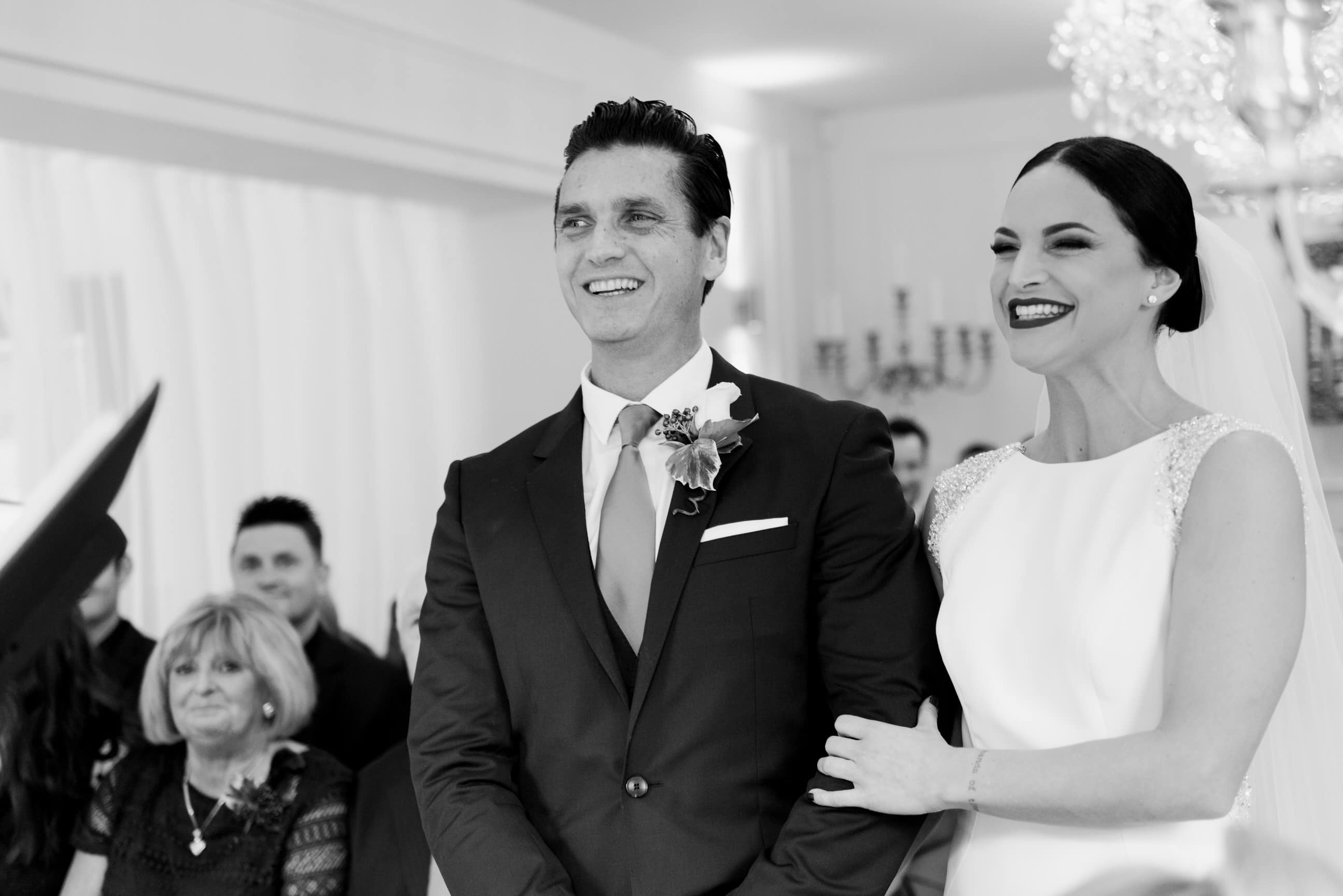 Bride and groom in ceremony, smiling