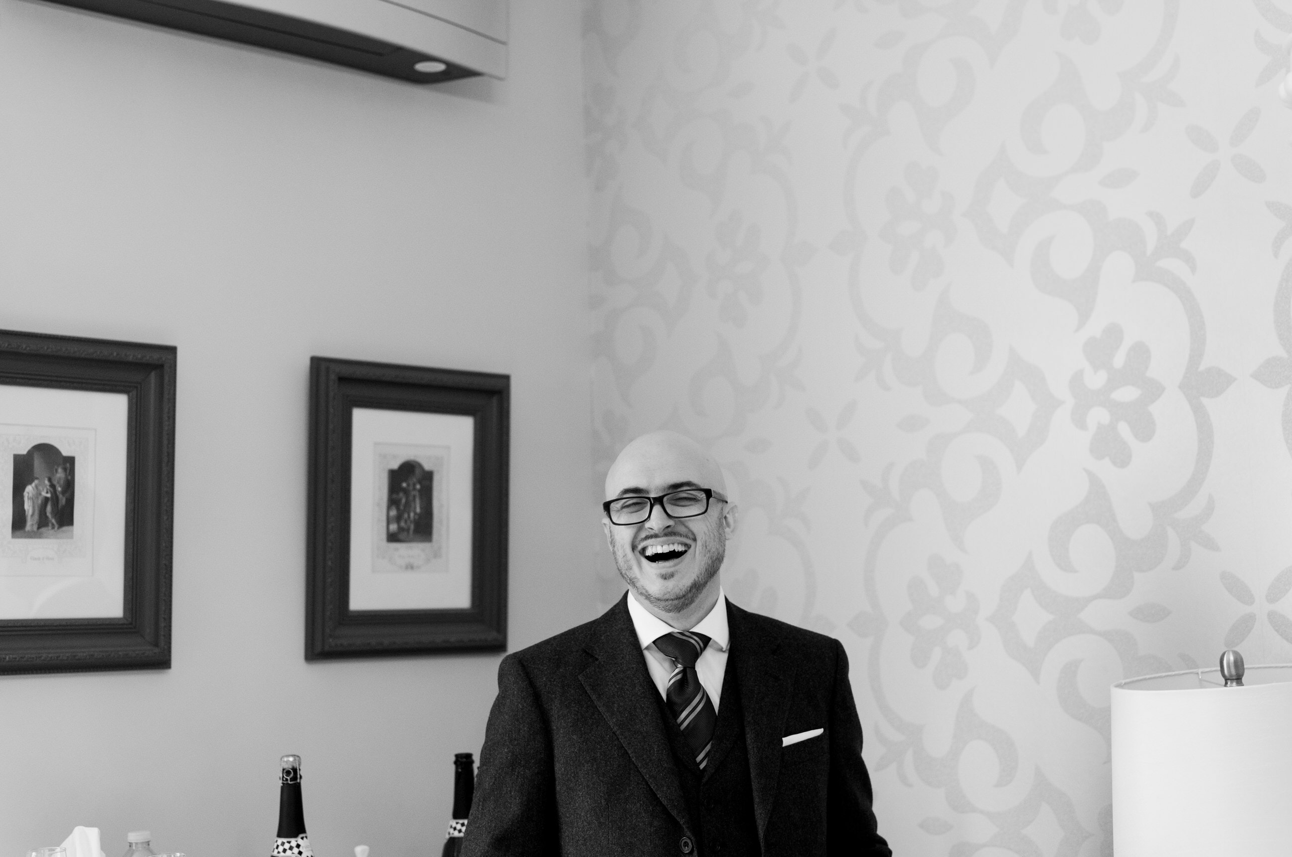 Groomsman in suit, laughing