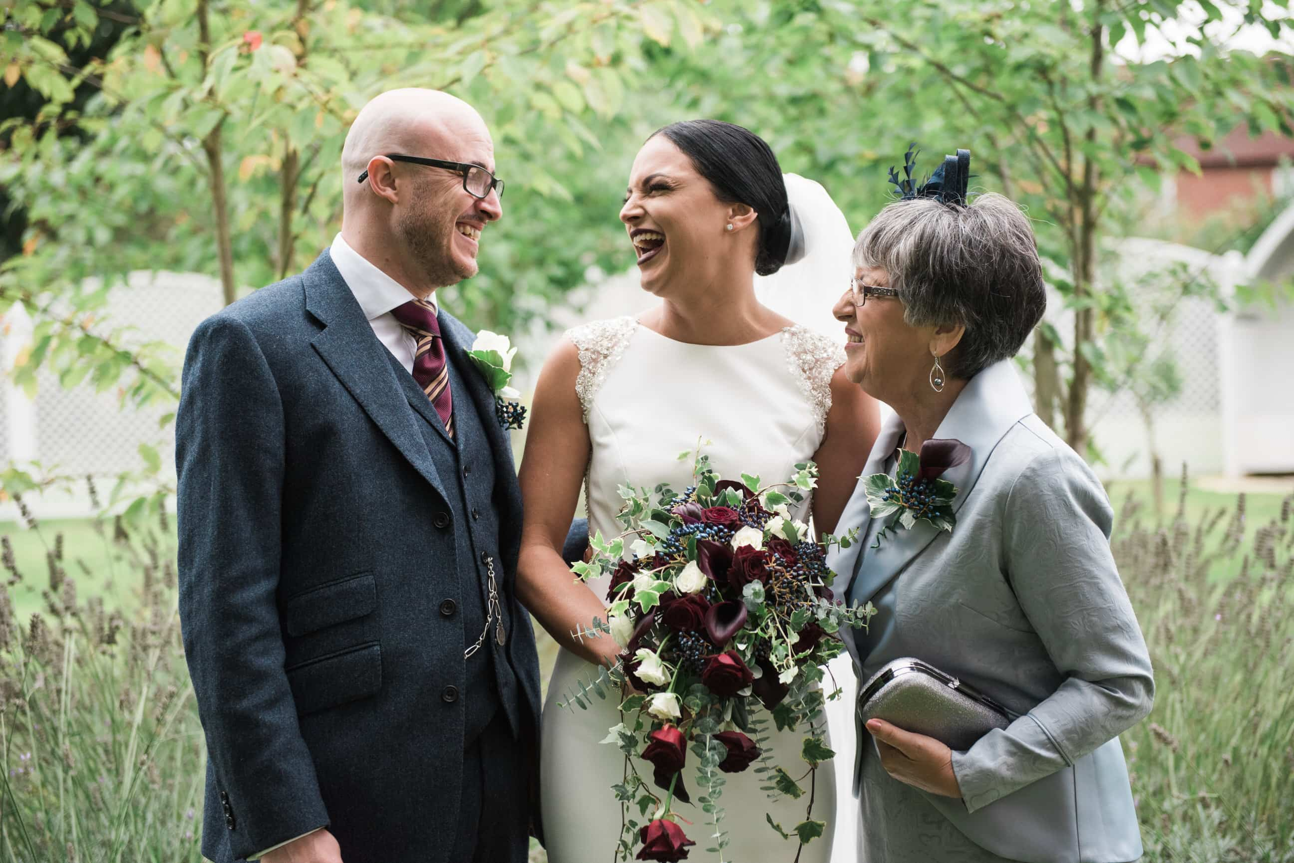 Bride with family, laughing