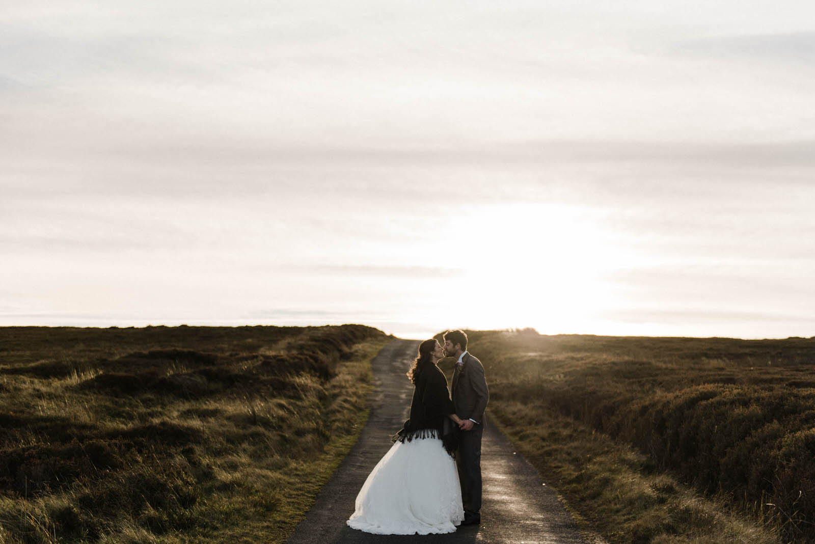 Fine art winter wedding photography at Danby Castle - bride and groom at sunset