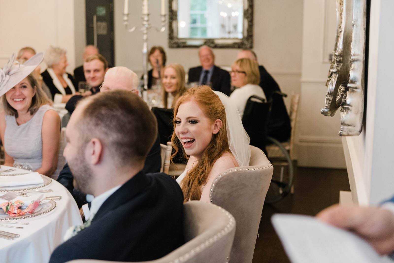 Bride laughing during wedding speeches - Old Vicarage wedding photography
