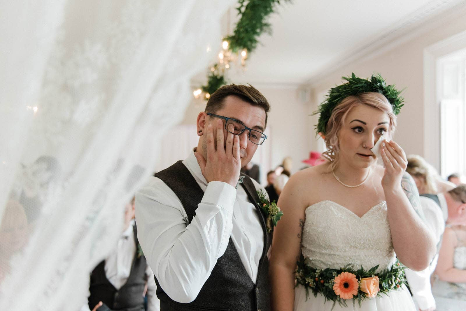 Emotional wedding photography of bride and groom crying during wedding ceremony at Hirst Priory