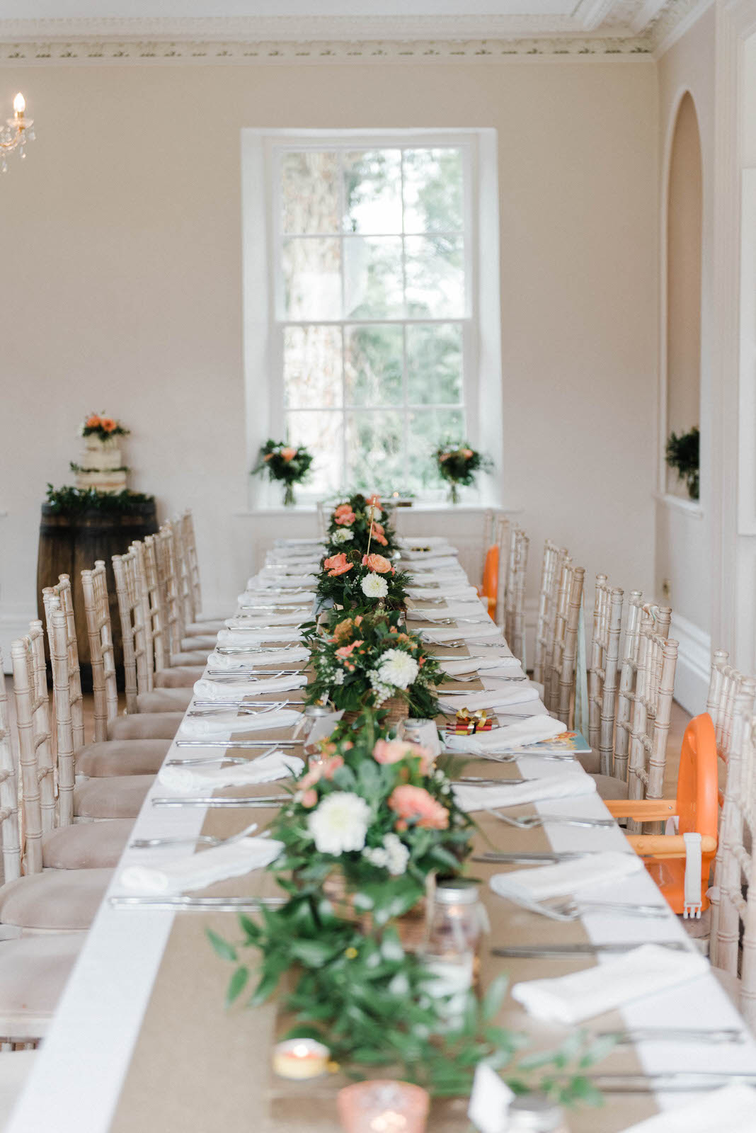 long wedding table with greenery table centres