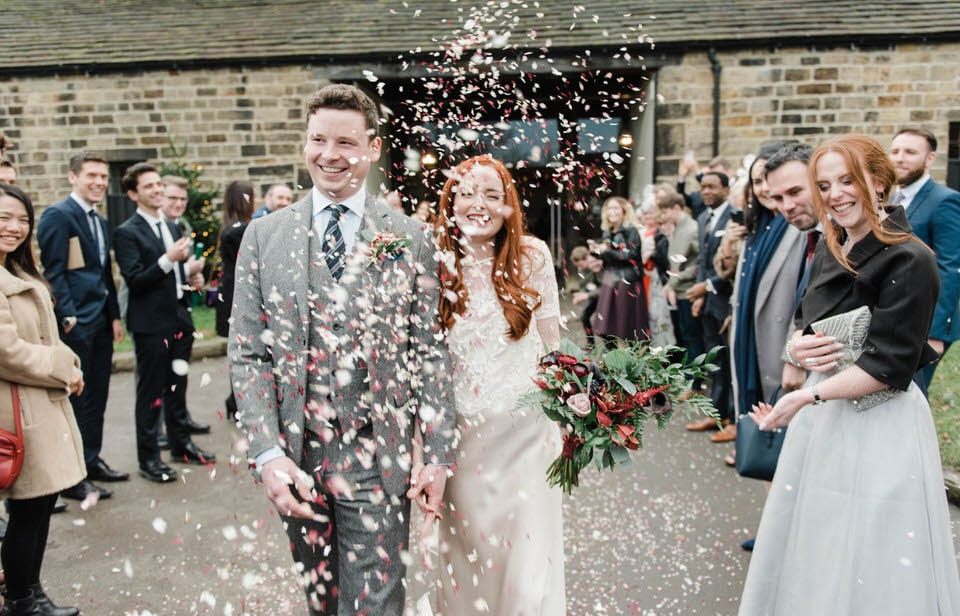 bride & groom in confetti shot at east riddlesden hall wedding