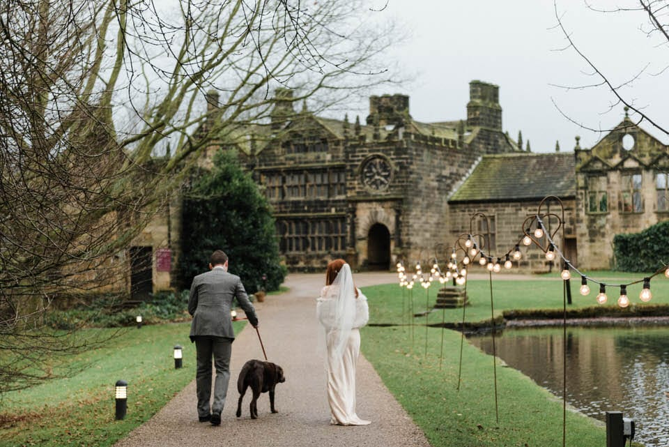 Bride & groom walking dog east riddlesden hall