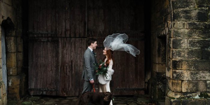 Bride and groom portrait veil blowing