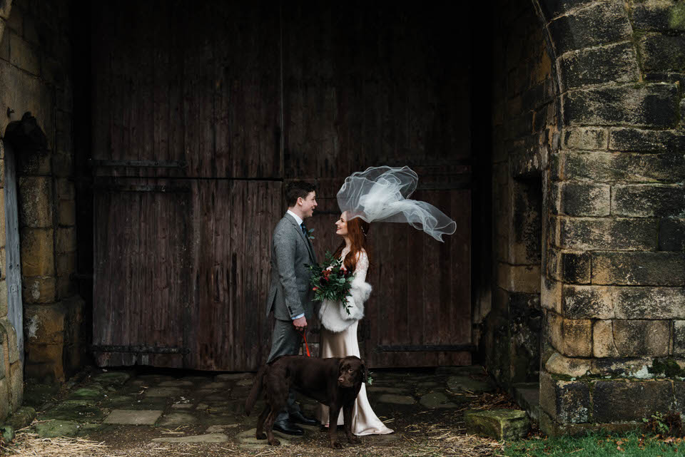 Bride and groom at east riddlesden hall wedding