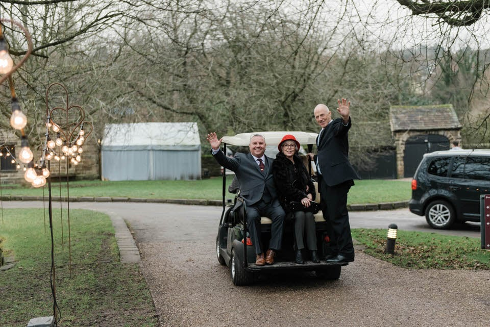 People riding golf buggy Riddlesden Hall