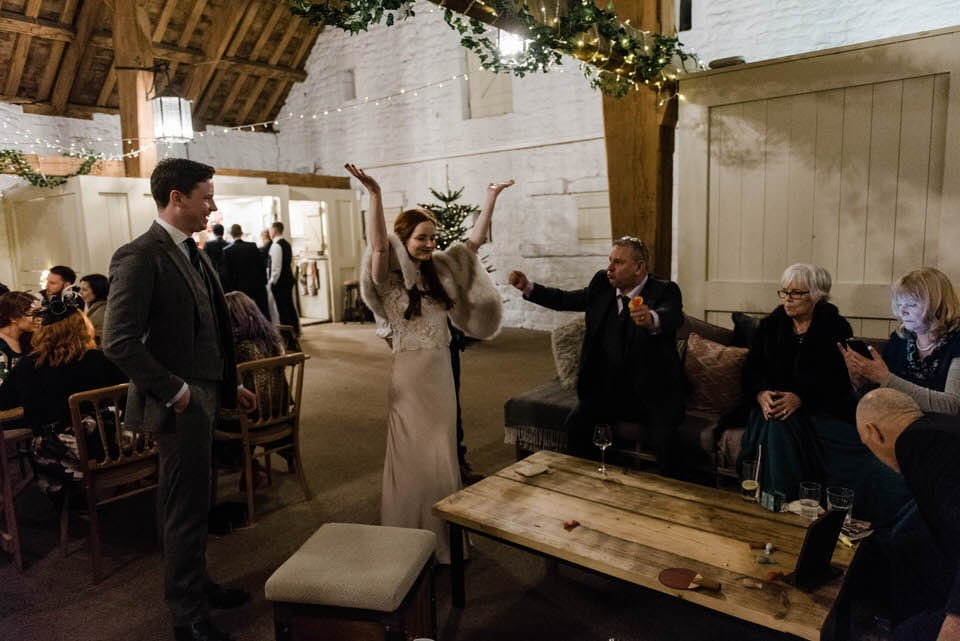 bride celebrating arms in air
